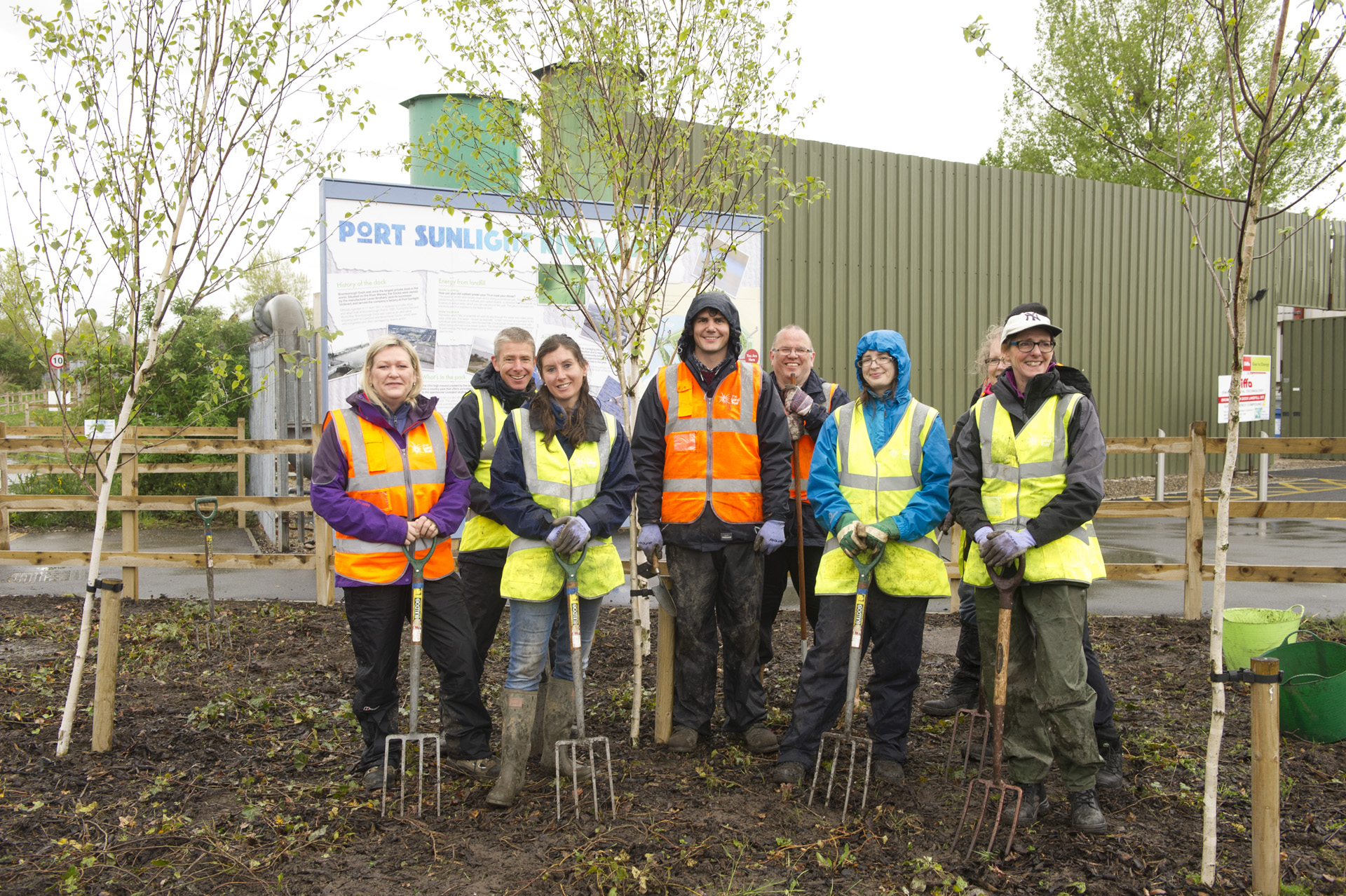 Group of people planting trees at Port Sunlight River Park