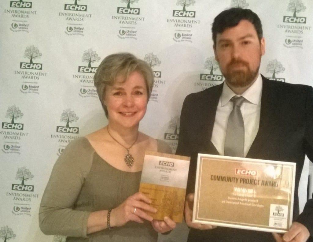 Carolyn and Rowan receiving award