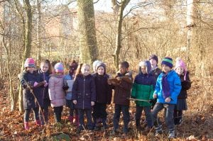 Schoolchildren celebrate the new Forest School area at Upton