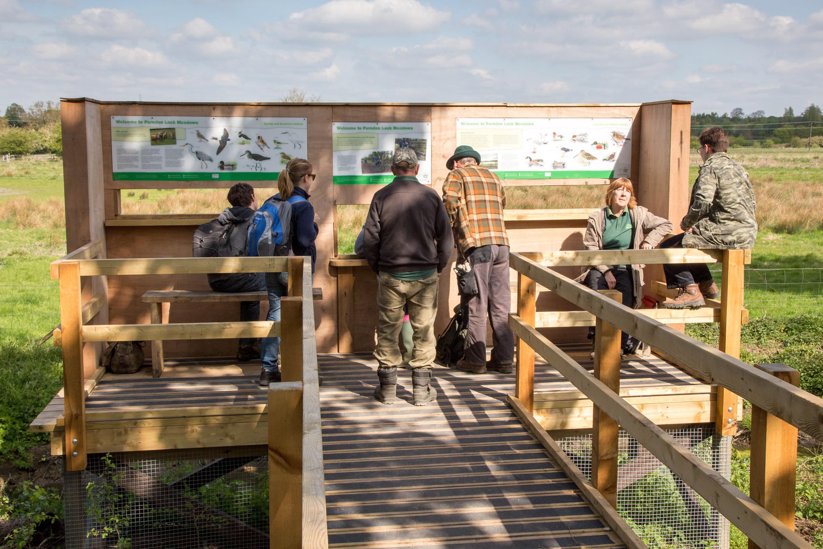 Viewing platform in use at Parndon Lock Meadows