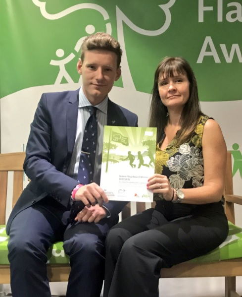 Groundwork West Midlands Board Member Ben Brittain and Operations Manager Julie Read collect the Green Flag Certificate