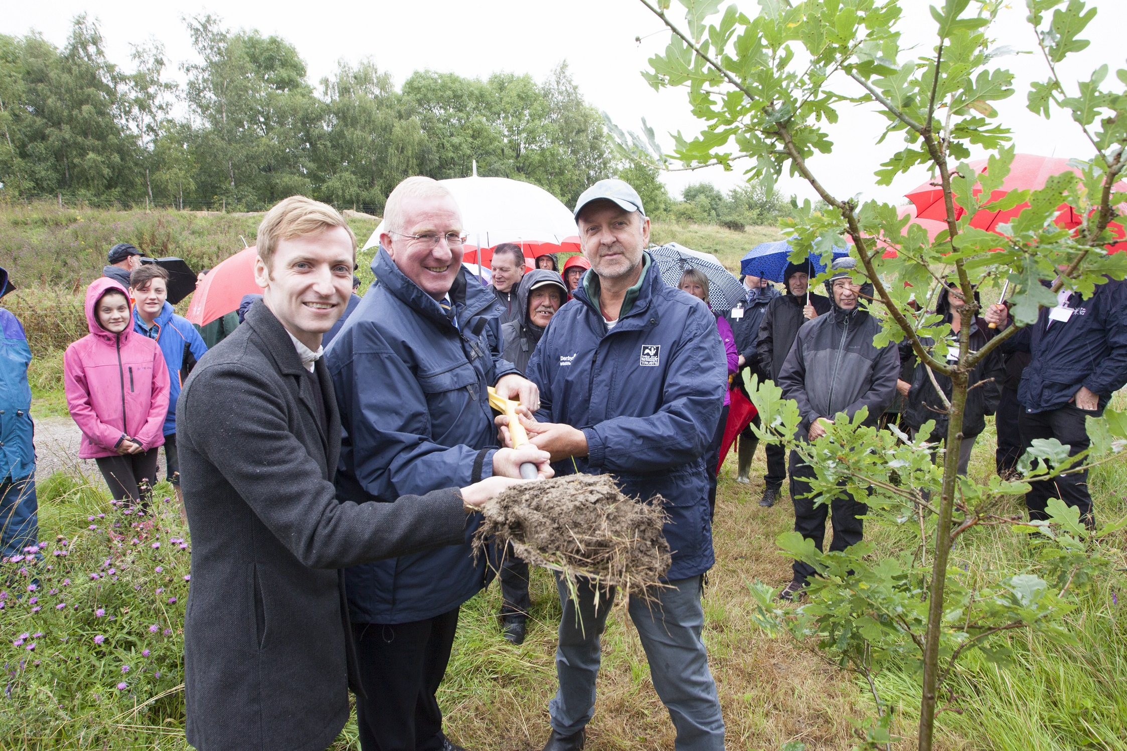 Planting an oak tree at Avenue Washlands Nature Reserve 10th anniversary